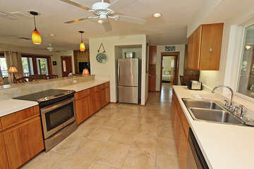 Newly updated kitchen offering stainless steel appliances, dining area and stack washer/dryer.