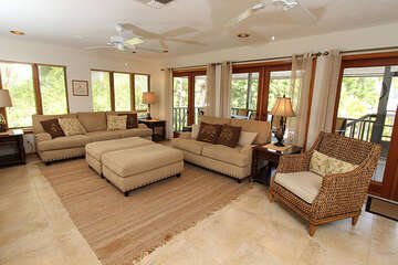 This vacation rental home offers a large living area with area with a flat panel TV.