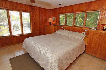 The master bedroom offers a king bed, TV and full bathroom