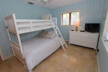 The third bedroom offers a bunk bed with a twin on top and double on the bottom along with a TV. Both bedrooms share a full bathroom.