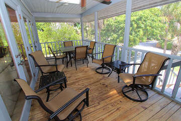 Spacious screened front lanai with plenty of seating available.