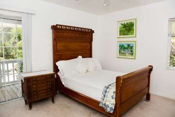 Guest bedroom with full bed.