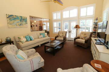 Nicely appointed living room with comfortable furniture.