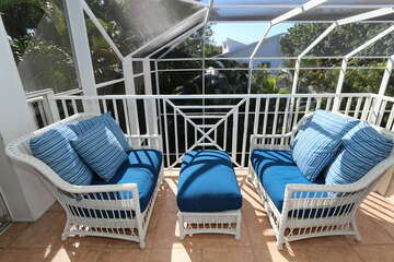 Patio under screen outside the master bedroom overlooking the pool area.