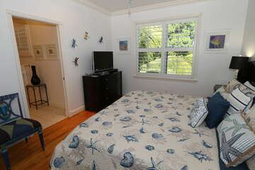 Guest bedroom 1 offers natural light and private bathroom.