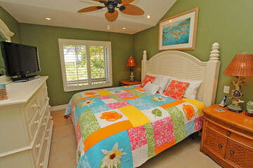 Master bedroom is colorful and comfortable.