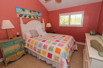 Guest bedroom also colorful and fun.