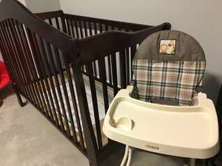 Crib and Highchair located in garage