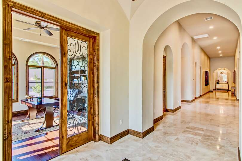 Hallway of this vacation home rental in Phoenix, with game room to the left.