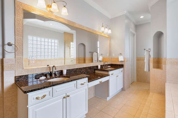 Plenty of space to get ready in this exquisite master bathroom
