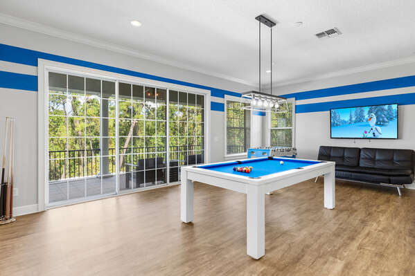 This upstairs lounge area is fully equipped with a pool table, air hockey, Foosball table, SMART TV for entertainment, and a bathroom