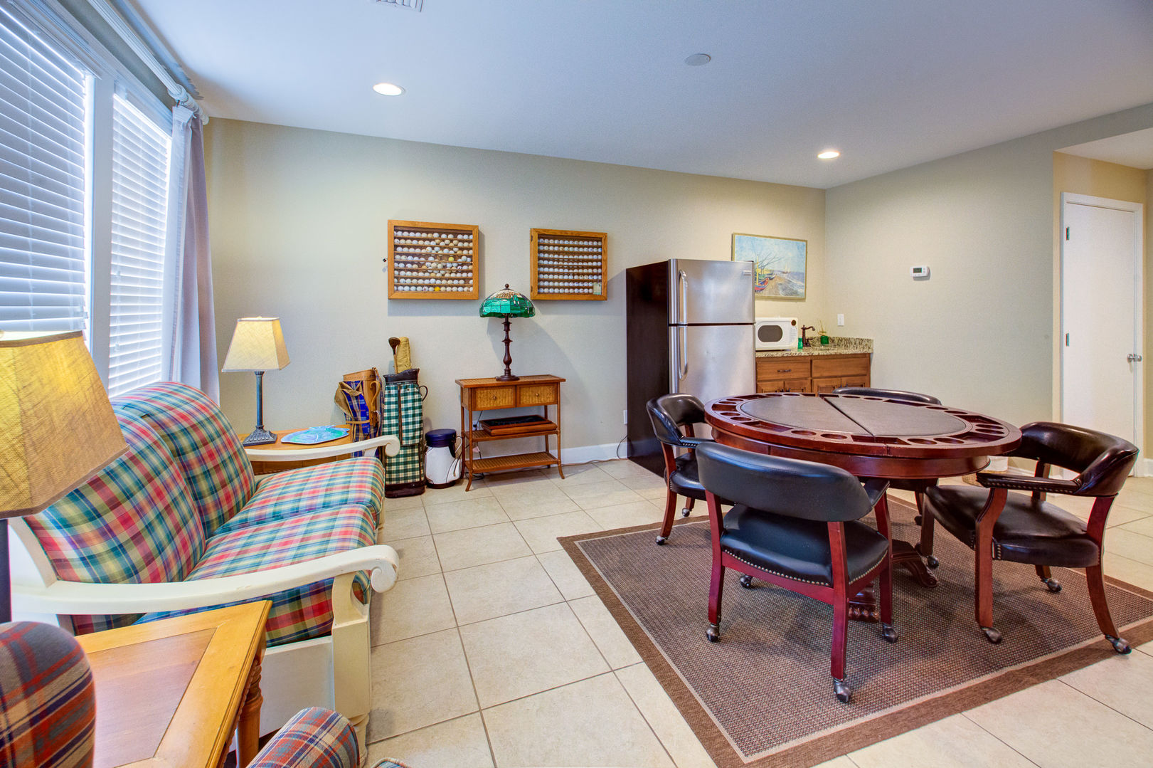 Sofa, Side Tables, Lamps, Poker Table, Refrigerator, and Wet Bar.