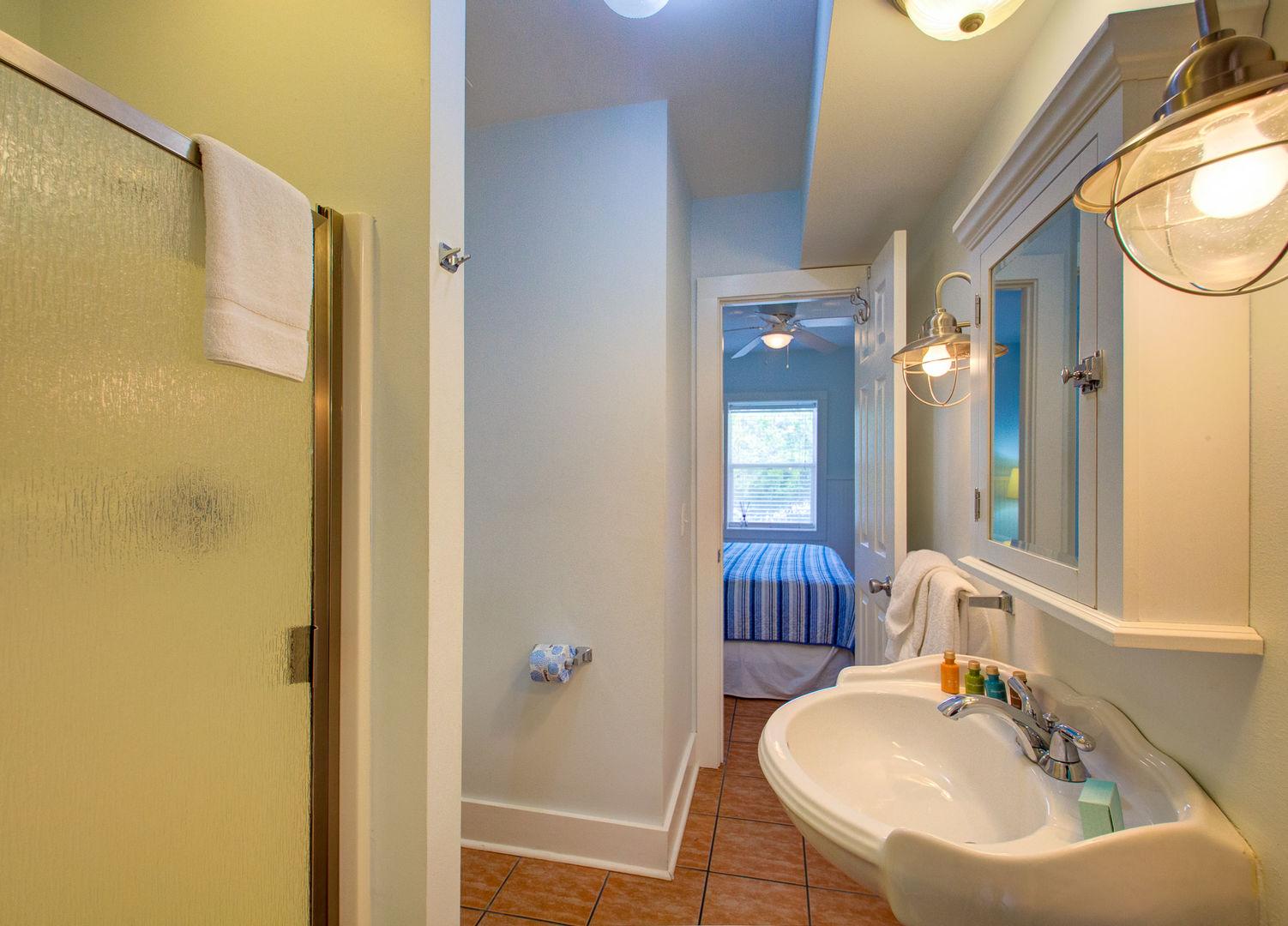 Pedestal Sink, Cabinet Mirror, and Shower.