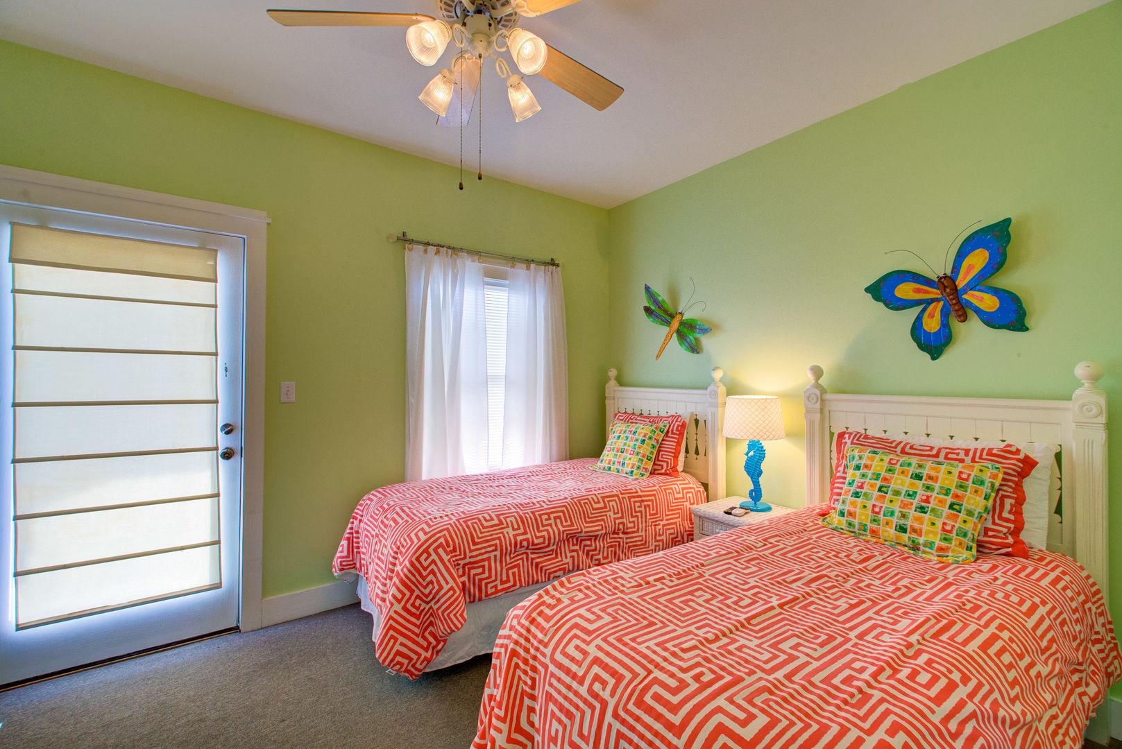 Bedroom with Twin Beds, Nightstands, Lamp, Door to the Balcony.
