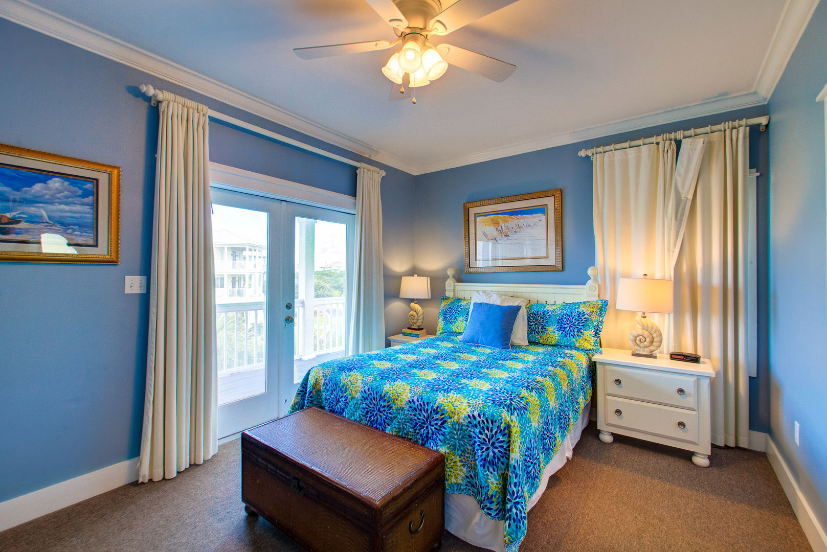 Large Bed, Nightstands, Lamps, Doors to the Balcony, and Storage Trunk.