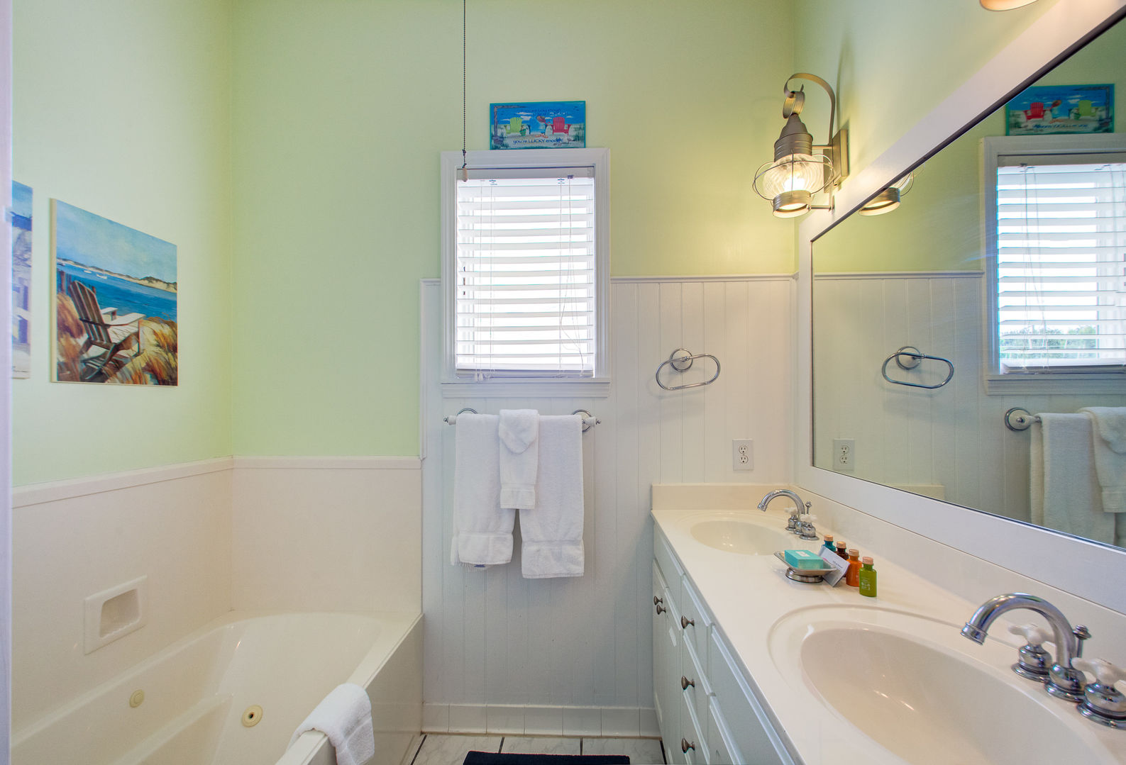 Double Vanity Sink, Bathtub, and Mirror.