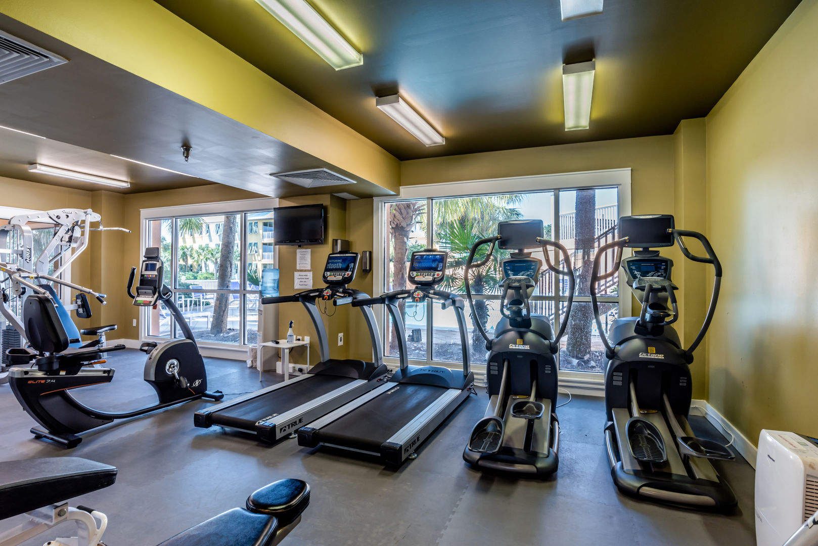 Fitness Center with Treadmills and Elliptical Machines.