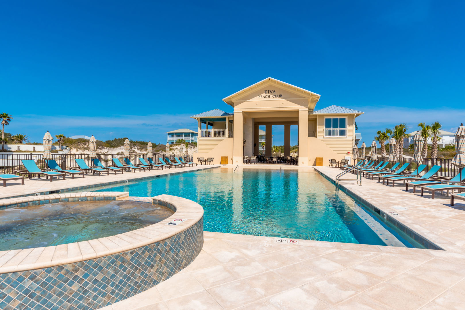 The Pool of the Kiva Beach Club, Lounge Chairs, and Umbrellas.