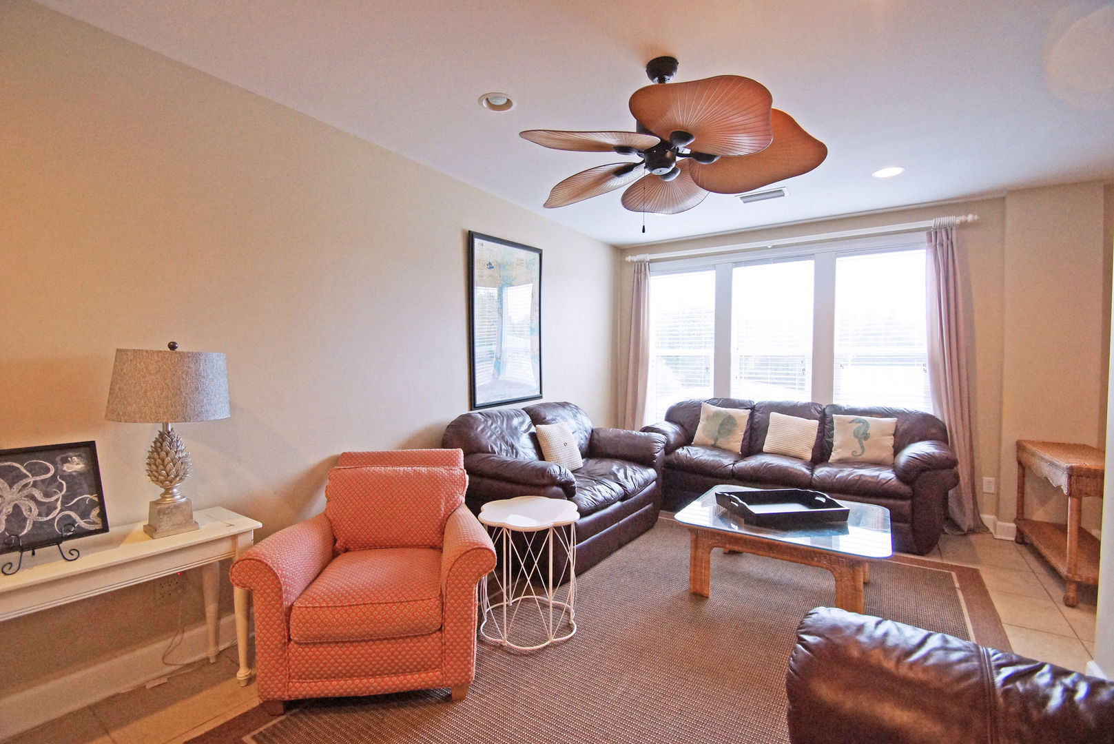 Arm Chair, Console Table, Lamp, Sofas, Coffee Table, and Ceiling Fan.