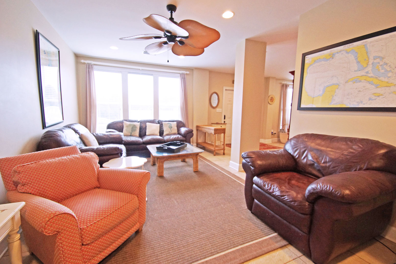 Arm Chairs, Sofa Table, Sofas, Coffee Table, and Ceiling Fan.