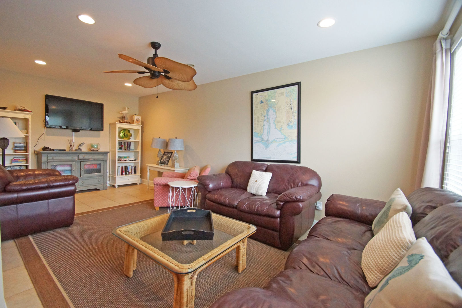 Buffet Console, TV, Sofas, Coffee Table, and Ceiling Fan.