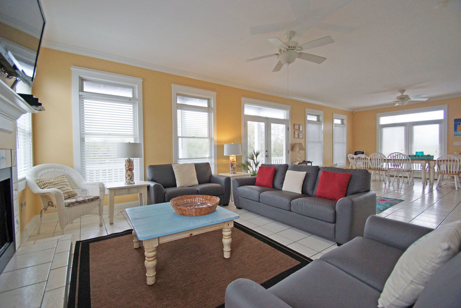 Sofas, Coffee Table, Fireplace, TV, Ceiling Fan, Dining Set, and Windows