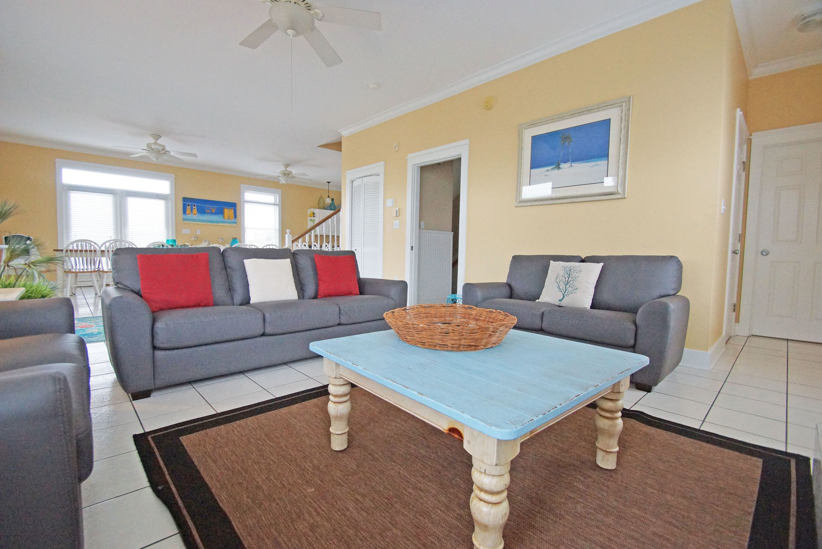 Sofas, Coffee Table, Ceiling Fan, Dining Set, and Windows.