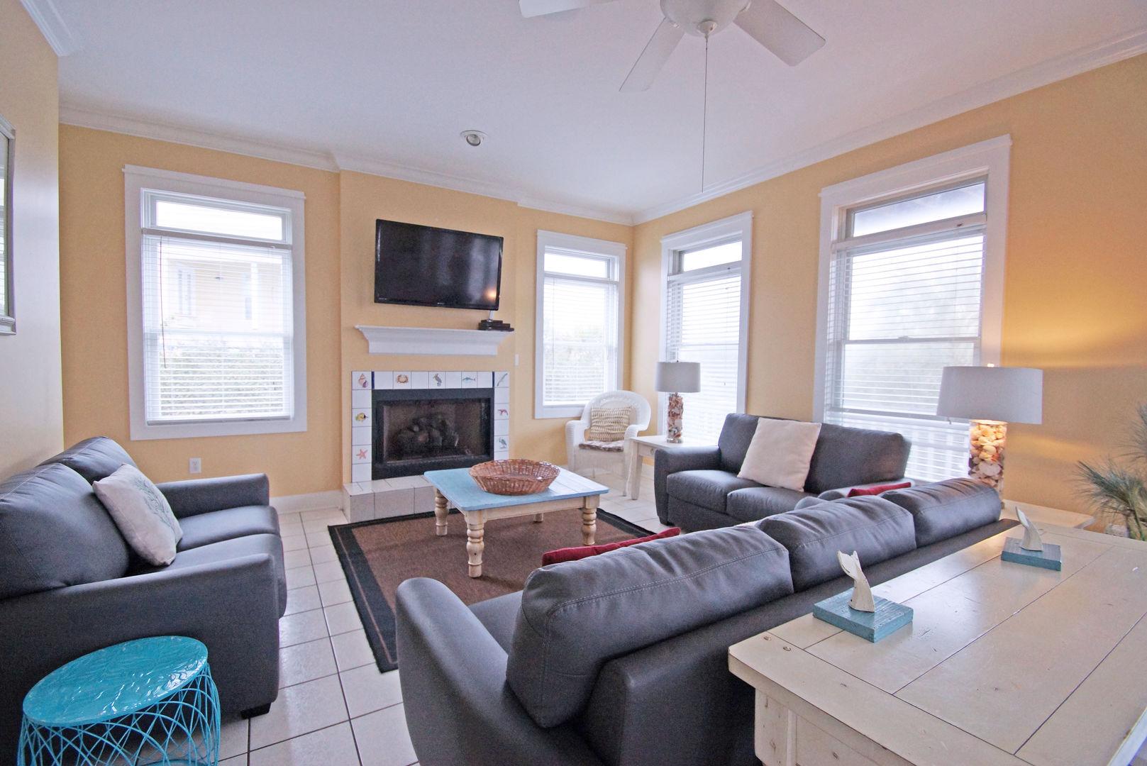 Sofas, Coffee Table, Fireplace, Sofa Table, TV, and Windows.