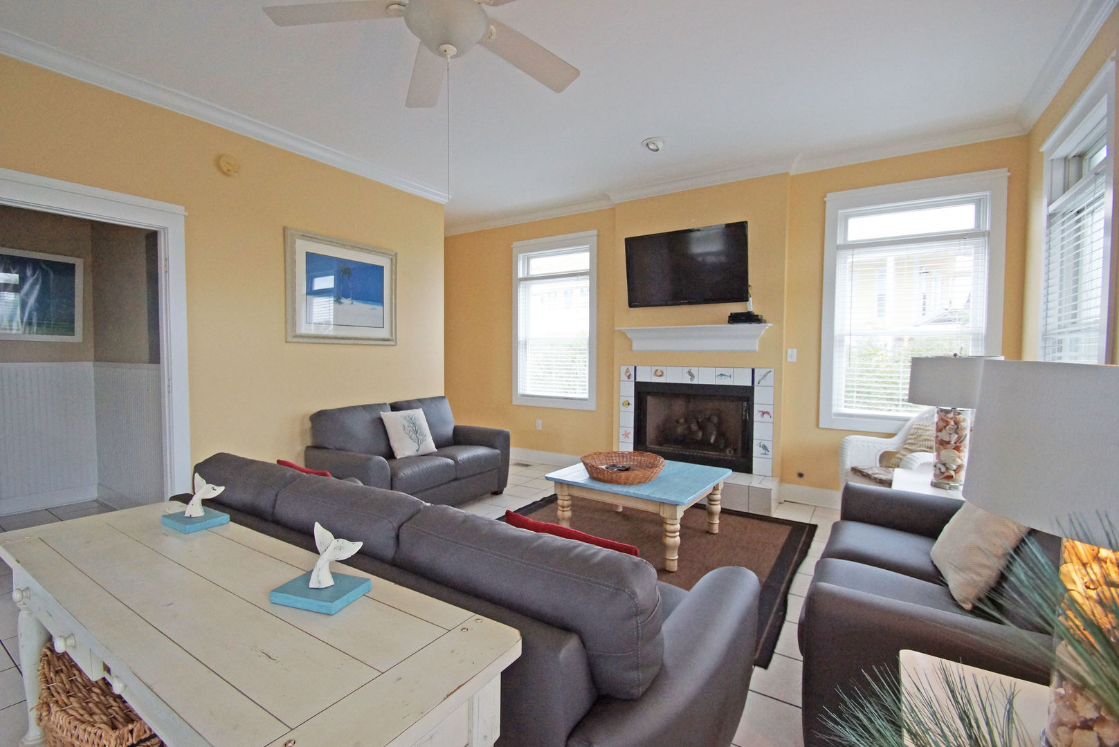 Living Area with Sofas, Coffee Table, Fireplace, and TV.