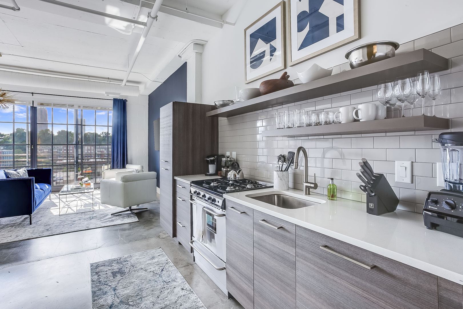 This kitchen at this Ponce Rental features and oven, sink and fridge