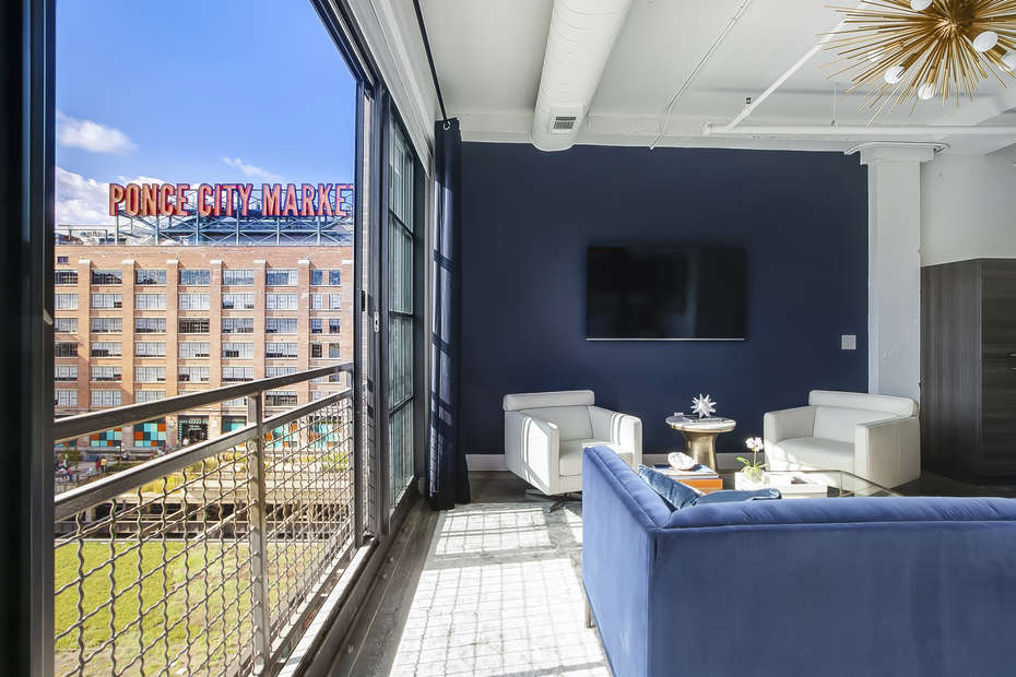 This Ponce Rental has a living area with view of the Ponce City Market