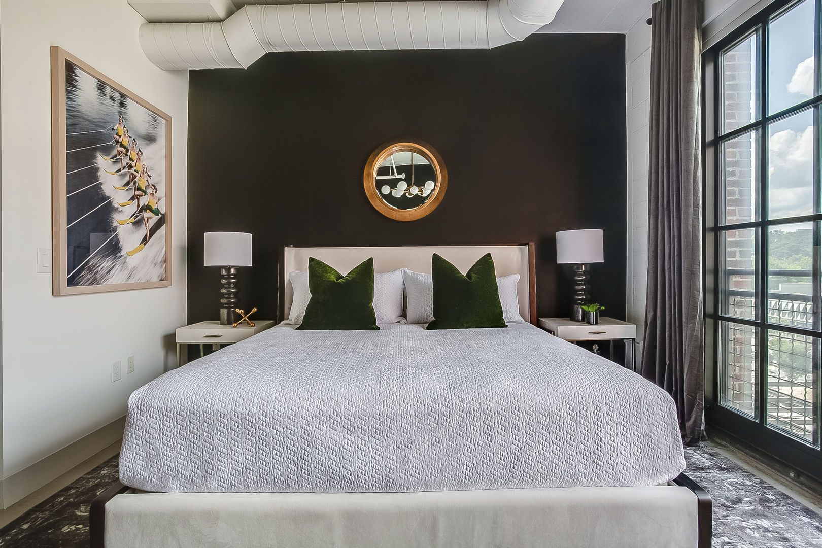 Sleeping area with bed, two nightstands and nearby window