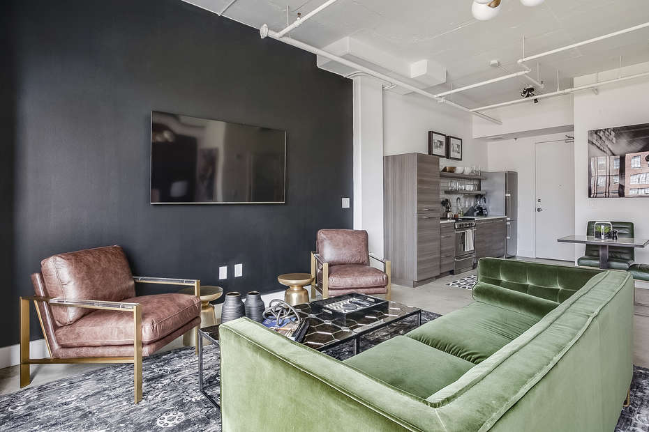 Living area with couch and wall mounted TV