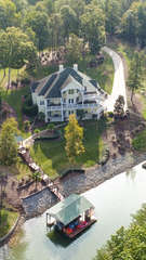 Arial View of the home - surrounded by lush forestry!