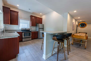 Full kitchen - oven/stove combo, full size fridge, dishwasher, full set of kitchenware.