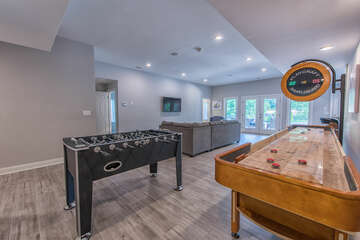 Foosball, Shuffle Board, and sectional with ample seating.