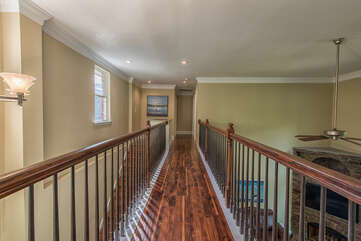 Walk down to other second floor bedrooms.