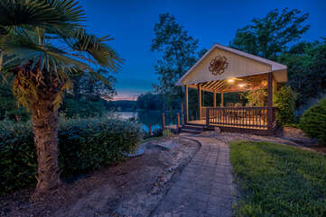 Gazebo with dining area, outdoor sink and fridge.