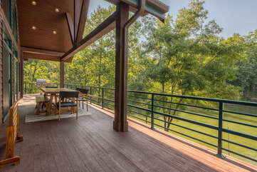 Full house length deck, no lack of view from this lakeside cabin