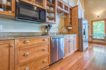 Stainless appliances in the kitchen give this house a modern feel.