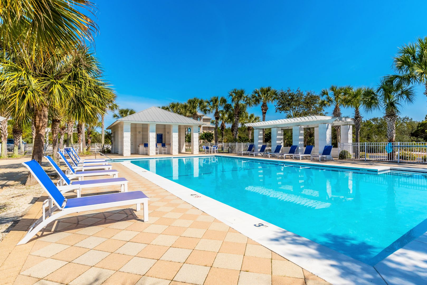 A Photo of Lounge Chairs and Large Pool.