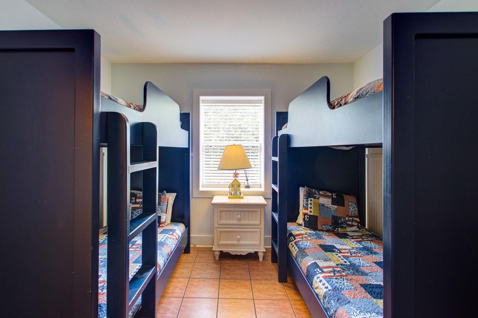 Bedroom #1 has 2 twin beds to sleep 4.