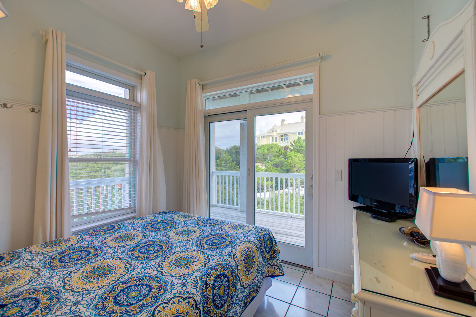 Bedroom Has Balcony Access and an LCD TV.