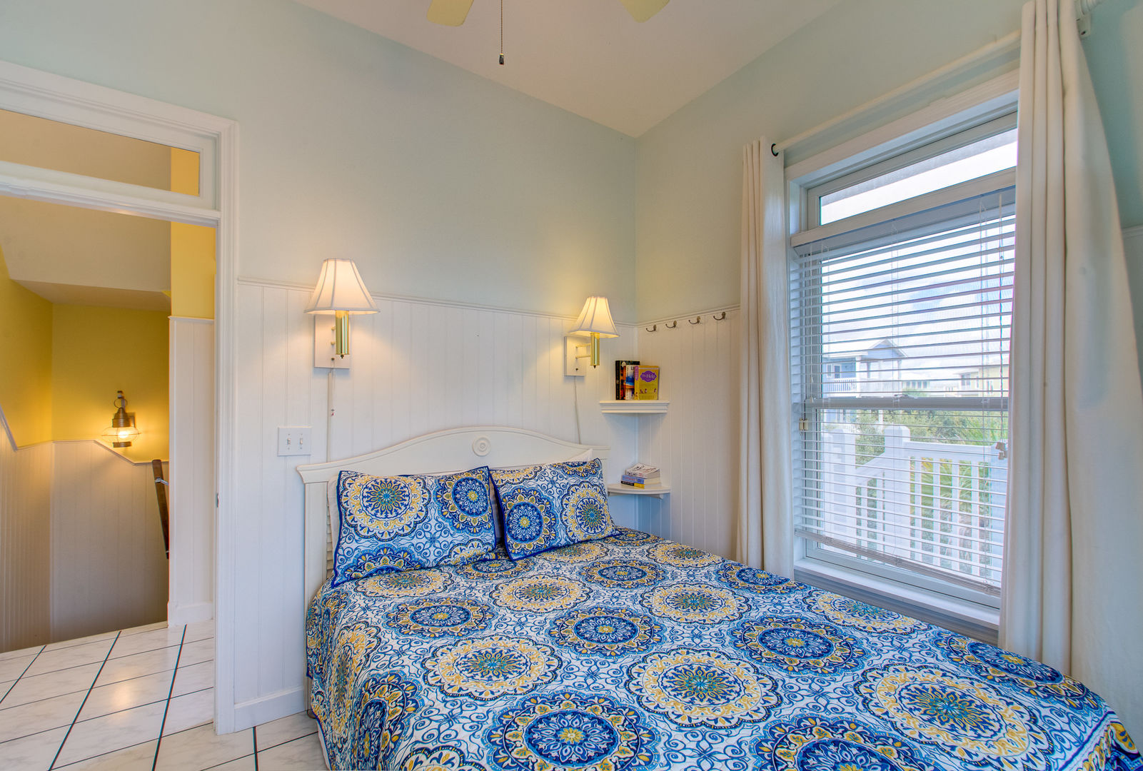 Bedroom Features Queen-Sized Bed and Large Window.