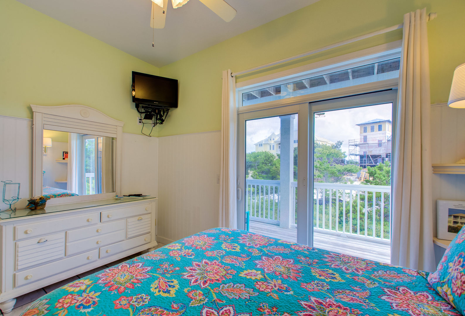 Enjoy an LCD TV and Balcony Access From Bedroom.