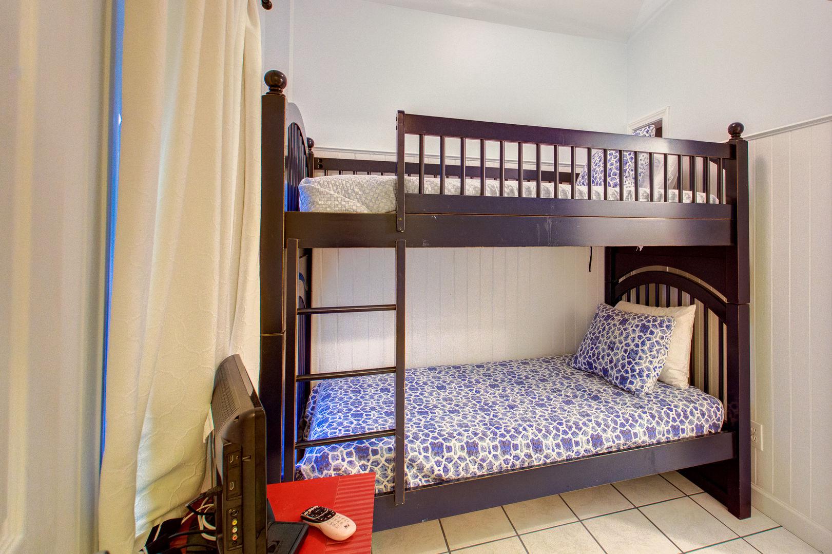Bedroom Features Wooden Bunk Bed.