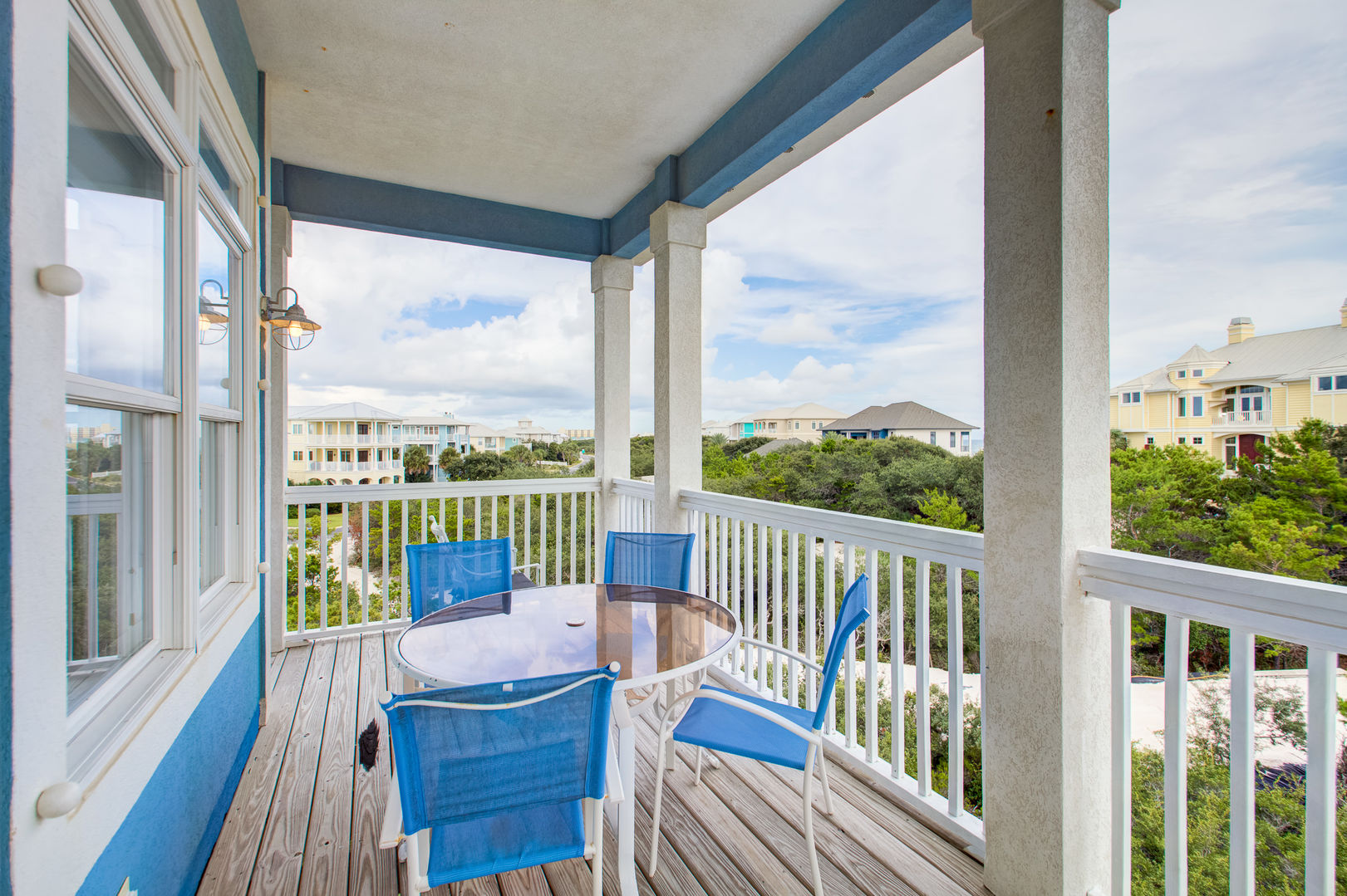 Enjoy a Meal on the Balcony of Vacation Home in Gulf Shores.