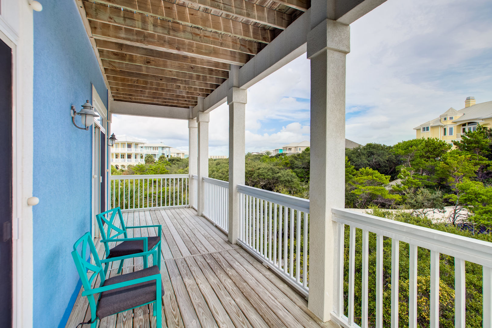 Enjoy Seating on the Balcony of Vacation Home in Gulf Shores.