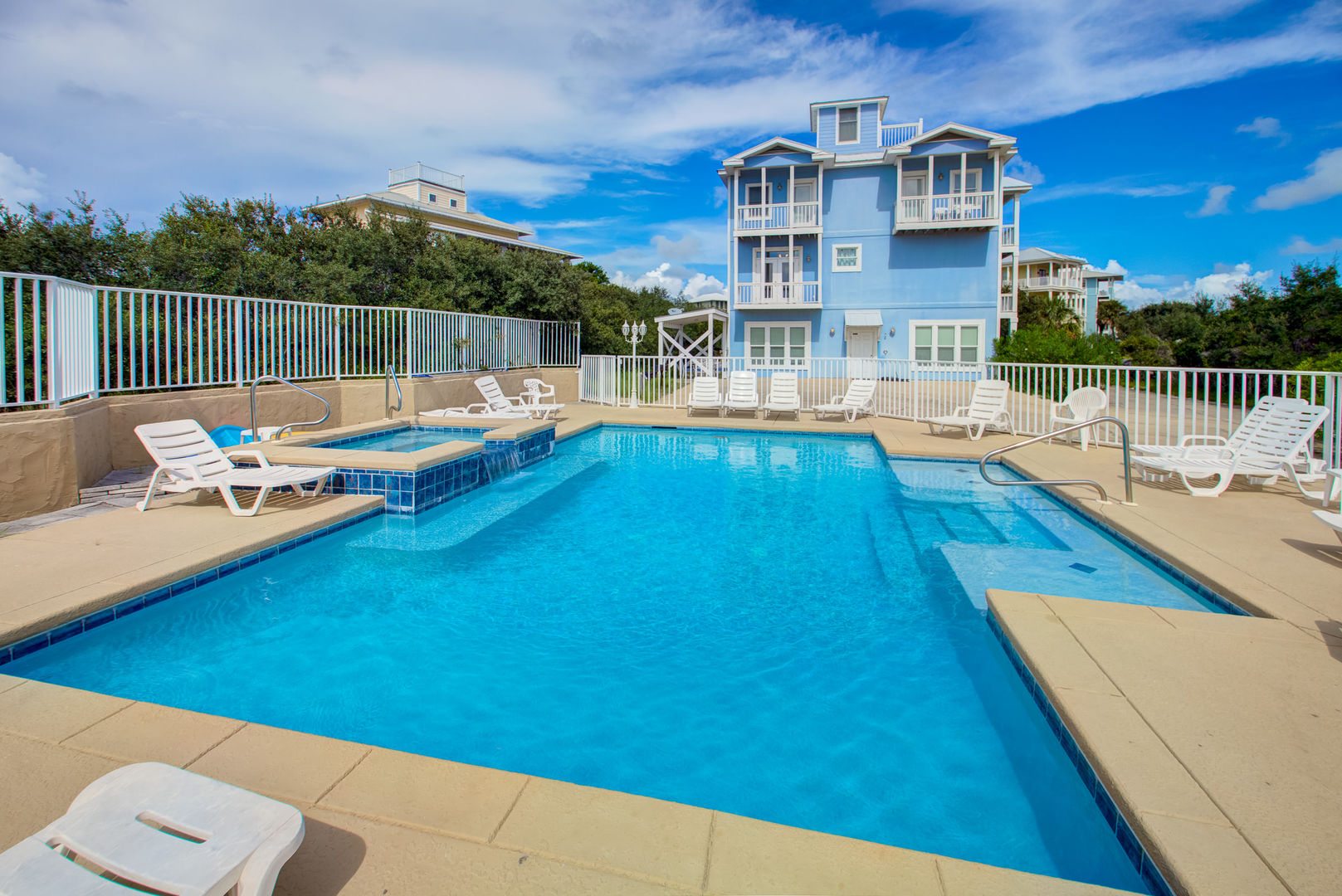 Guests Can Relax by the Large Community Pool.