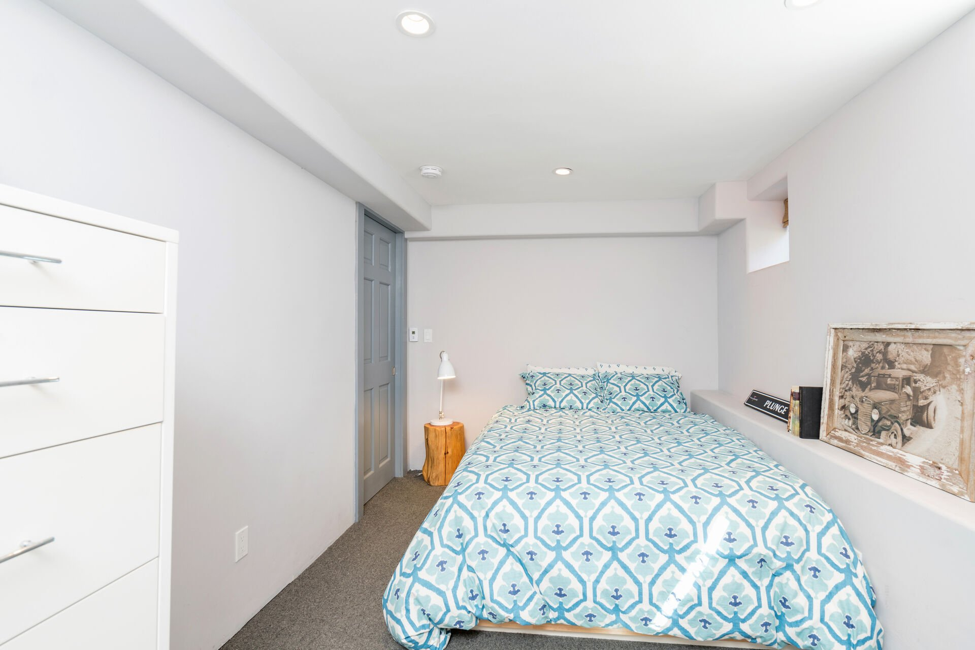 Bedroom with nearby nightstand.